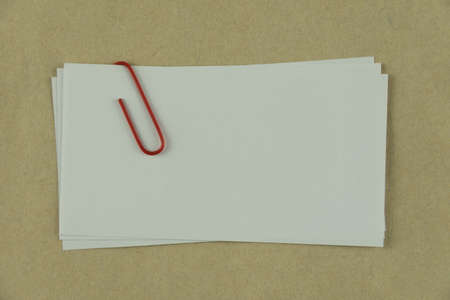 sheet metal: white note paper with red paper clip