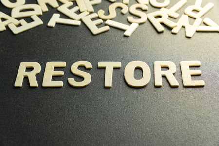 restored: RESTORE word made with wooden letter Stock Photo