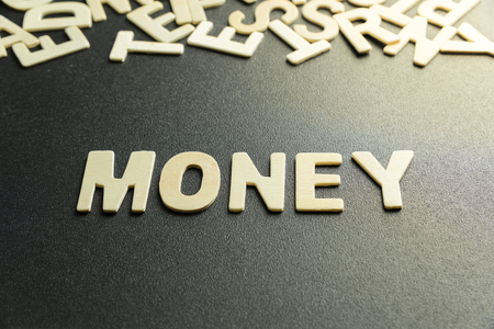 MONEY word made with wooden letter