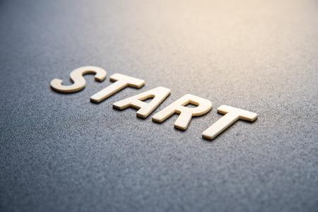 wooden letter of word  start on black background Stock Photo