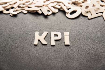 wooden letter of word  KPI on black background Stock Photo