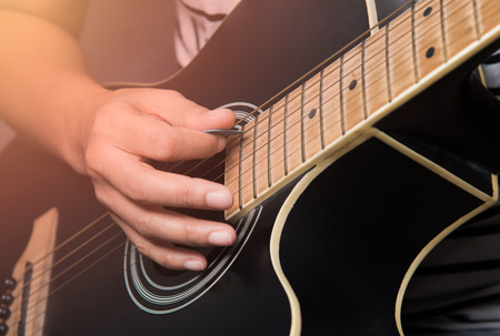 practicing playing guitar Stock Photo
