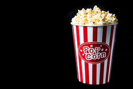 pop corn in bucket on black background