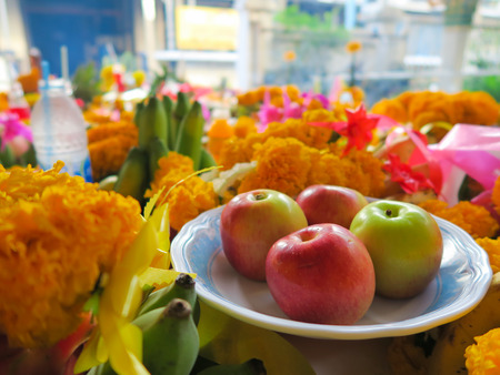 apple and some marigold for worship to holy thing according to belief of buddhist in Thailnad