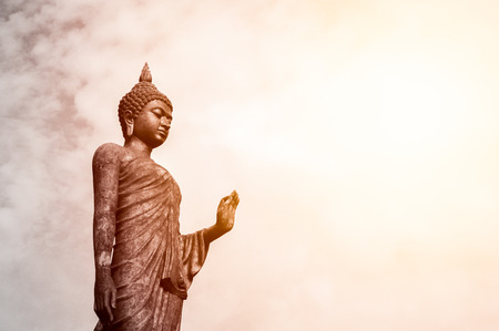 Standing buddha statue at Buddhist park in the Phutthamonthon District, Nakhon Pathom Province of Thailand, was given the name Phra Si Sakkaya Thotsaphonlayan Prathan Phutthamonthon Suthat