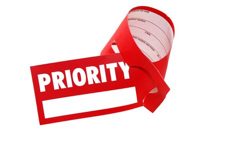 priority red paper sign for luggage isolated over white photo