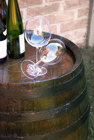 glasses and bottles of wine over wooden barrel Stock Photo - 3769999