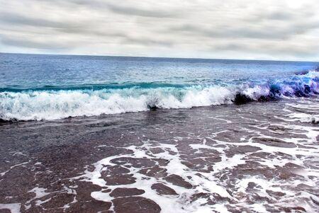 seacoast: wide seashore, horizon over Adriatic sea and cloudy sky