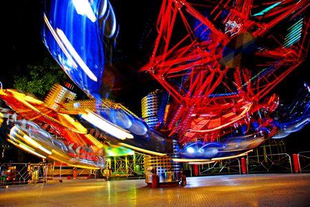 terrific speed of carousel in evening park Stock Photo