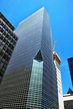 upper floor: Modern office buildings in New York over blue sky Stock Photo