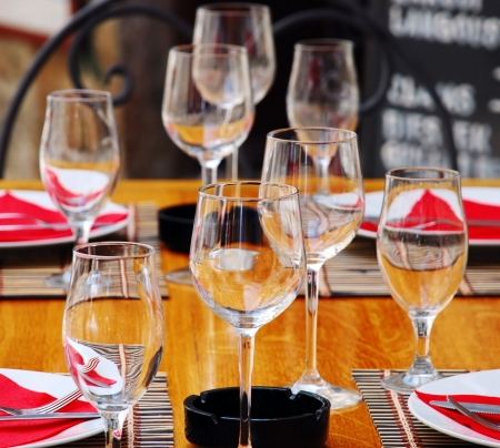 wineglasses and plates on table in restaurant Stock Photo - 3810452