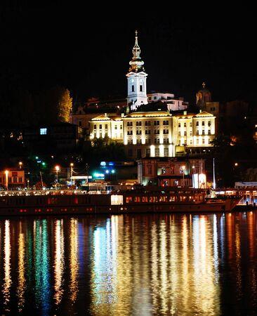 riverine: night illuminated Belgrade cityscape