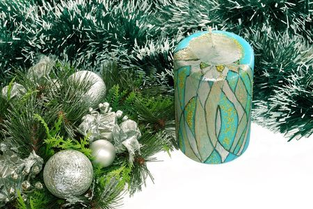 adorning: Decorative candle over green new year adorning