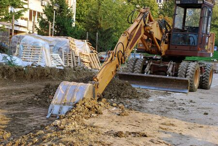 working area: bulldozer on building site outdoor urban scene Stock Photo