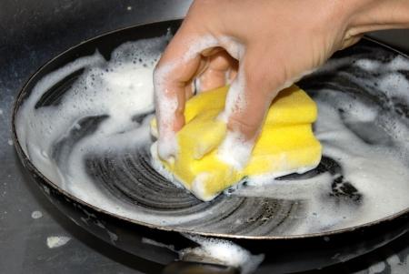 female hand washing frying pan closeup Stock Photo - 3880073