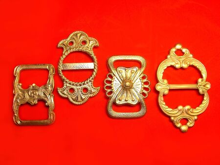 buckles: Silver buckles over red background
