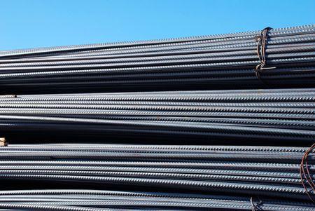pressured: iron armature stacks on storage outdoor background Stock Photo