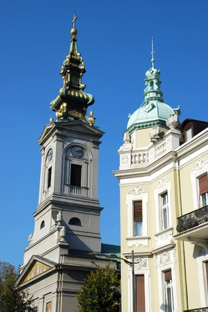 serbian: orthodox cathedral and tower of classic building  over blue sky Stock Photo