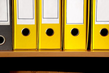 pasteboard: yellow pasteboard files in row close up crop Stock Photo