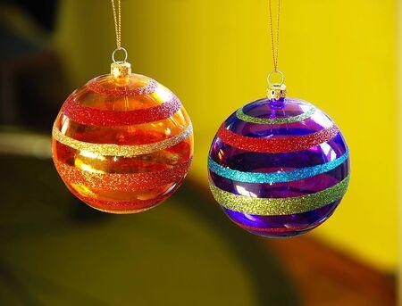 two purple and orange christmas balls decorations closeup Stock Photo - 4025081