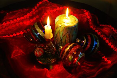 christmas collage with burning candles, decorative balls and glass photo