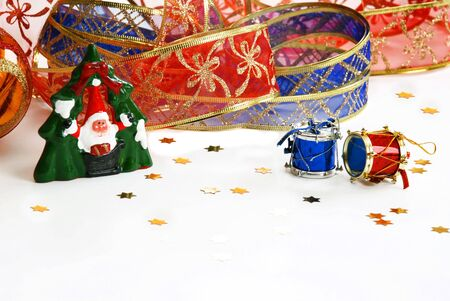 christmas decorative ribbon and toys on white photo