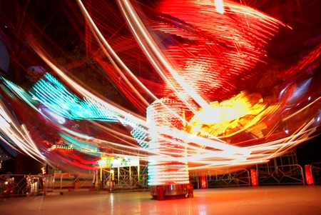 terrific: terrific speed of carousel in evening park Stock Photo