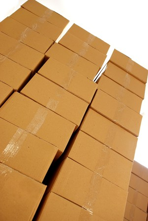commodity: piles of paper boxes with goods in storage