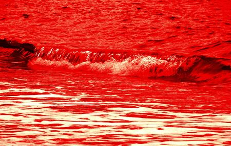 single bloody red wave on water background photo