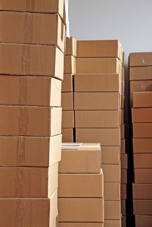 shipping supplies: piles of paper boxes with goods in storage