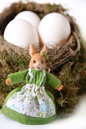 easter rabbit toy with white eggs in nest Stock Photo - 4211665
