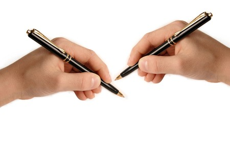 two hands writing nothing on white background