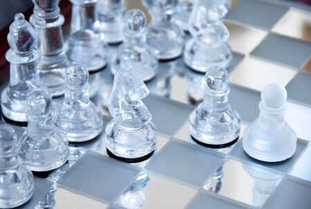 glass chessboard with first beginning position of pawn photo