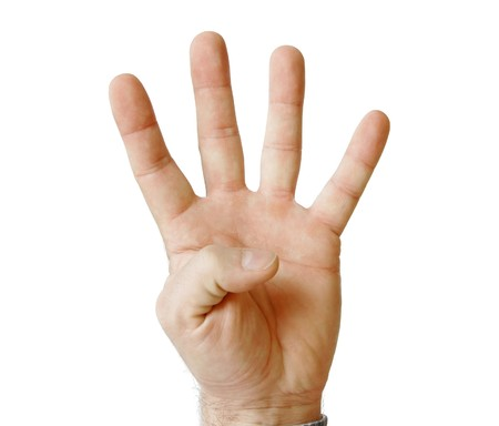 human palm hand showing four fingers isolated on white photo