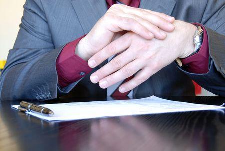 gesticulation: businessman hands on desk gesticulation Stock Photo