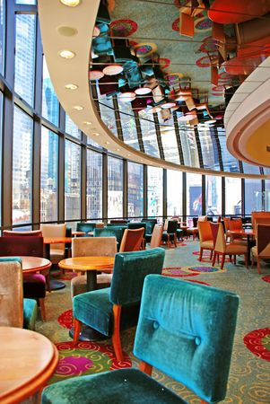 round restaurant with furniture in ceiling mirror reflection upside down photo