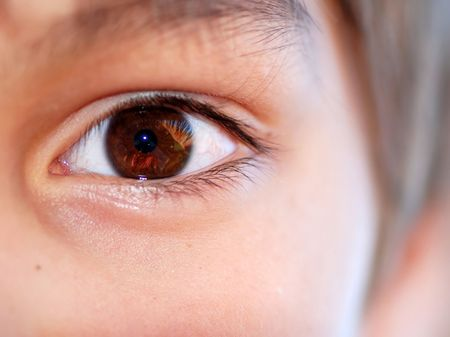 eyes open: human brown eye close up Stock Photo
