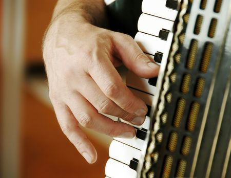 keyboard player: musician playing accordion Stock Photo