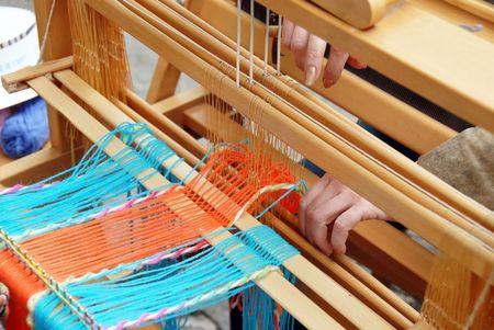 loom: wooden vintage loom, producing handmade garment