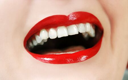 woman opened mouth white teeth and red lipstick laughing photo