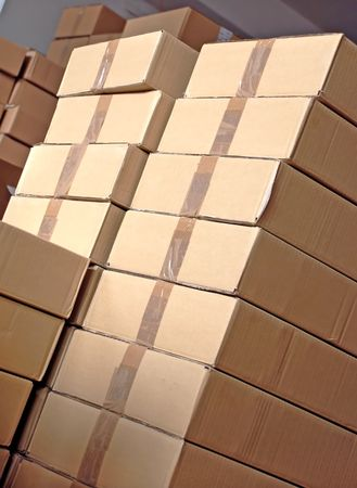 piles of paper boxes with goods in storage
