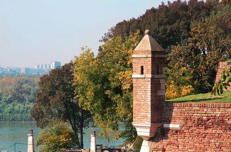 brick tower over autumn trees in park Kalemegdan in Belgrade photo