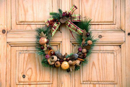 Christmas wreath on wooden door outdoor closeup Stock Photo - 4940740