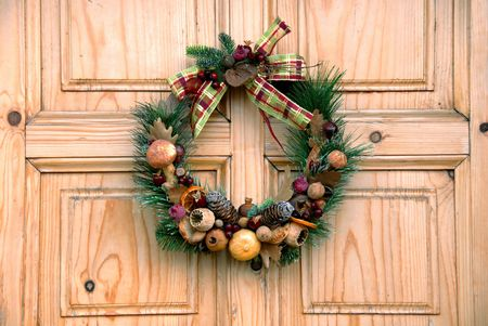 door leaf: Christmas wreath on wooden door outdoor closeup