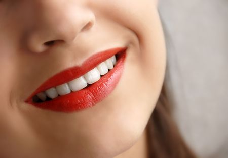 smiles: young girl beautiful red lips smiling closeup Stock Photo