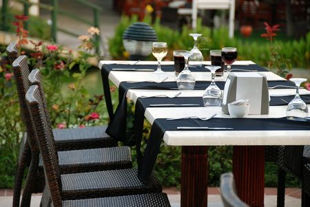 outdoor table with served plate and wine glasses photo