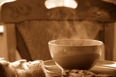 exhalation: dinner served on table, hot soup in bowl in sepia colors