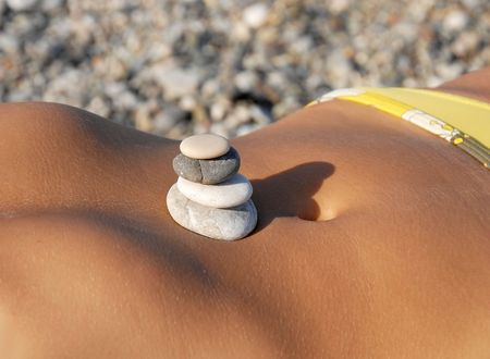 rocks in stack on woman sunburnt photo