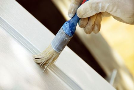 maintains: painting wooden door in white color by blue brush