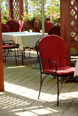 summer patio cafe restaurant chairs and tables photo